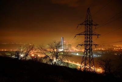 High voltage line in night-time lighting