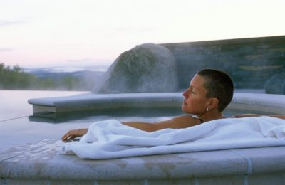 Caucasian Woman Sitting In An Outdoor Spa
