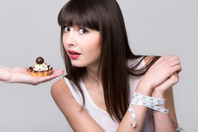Dieting woman got caught while trying to eat cake